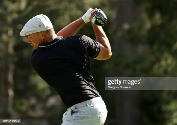 Bryson DeChambeau plays his shot from the fourth tee during the first round of the Rocket Mortgage Classic on July 01, 2021 at the Detroit Golf Club...