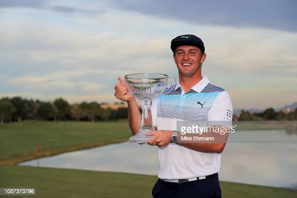 Bryson DeChambeau poses with the champion's trophy after winning the Shriners Hospitals for Children Open at TPC Summerlin on November 4 2018 in Las...