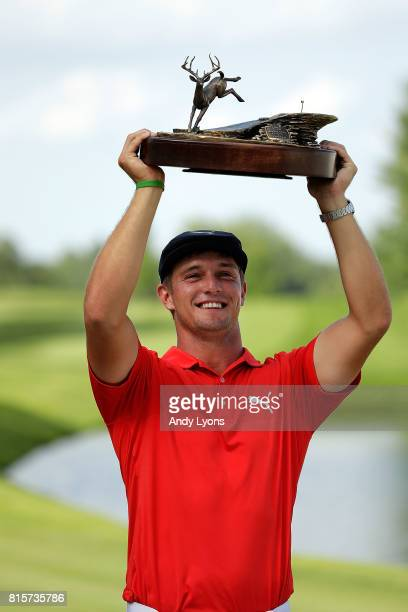 Bryson DeChambeau poses with the championship trophy following the final round of the John Deere Classic at TPC Deere Run on July 16 2017 in Silvis...