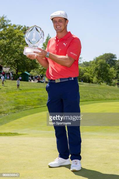 Bryson DeChambeau poses with the Memorial Tournament trophy after winning the second round playoff of the Memorial Tournament at Muirfield Village...