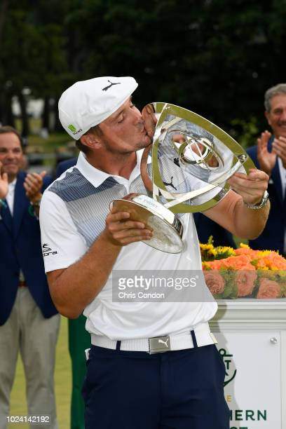 PARAMUS NJ AUGUST Bryson DeChambeau poses with the tournament trophy after winning THE NORTHERN TRUST at Ridgewood Country Club on August 26 2018 in...