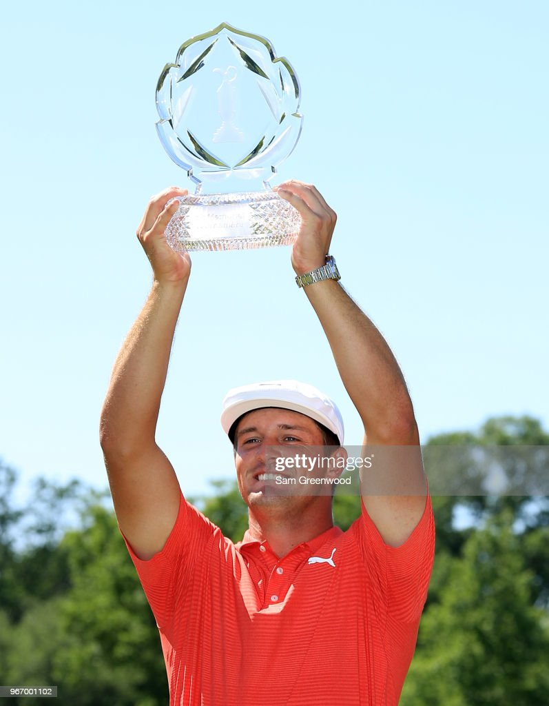 Bryson DeChambeau poses with the trophy after winning The Memorial Tournament Presented By Nationwide at Muirfield Village Golf Club on June 3, 2018 in Dublin, Ohio.