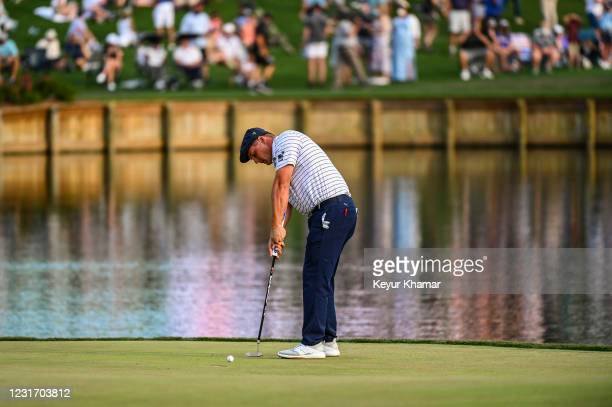 Bryson DeChambeau putts on the 17th hole green during the third round of THE PLAYERS Championship on the Stadium Course at TPC Sawgrass on March 13...
