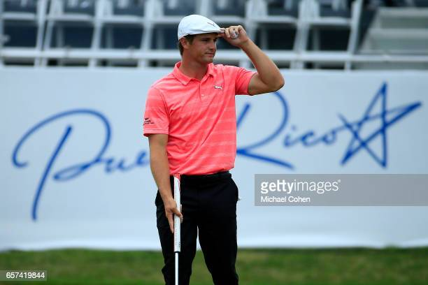 Bryson DeChambeau reacts after making his birdie putt on the 18th green during the second round of the Puerto Rico Open at Coco Beach on March 24...