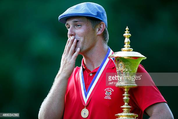 Bryson DeChambeau reacts to seeing friends while holding the Theodore A Havemeyer trophy after beating Derek Bard 76 during the final match of the US...