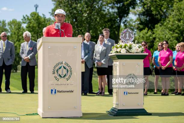 Bryson DeChambeau speaks to the crowd after winning the second round playoff of the Memorial Tournament at Muirfield Village Golf Club in Dublin Ohio...