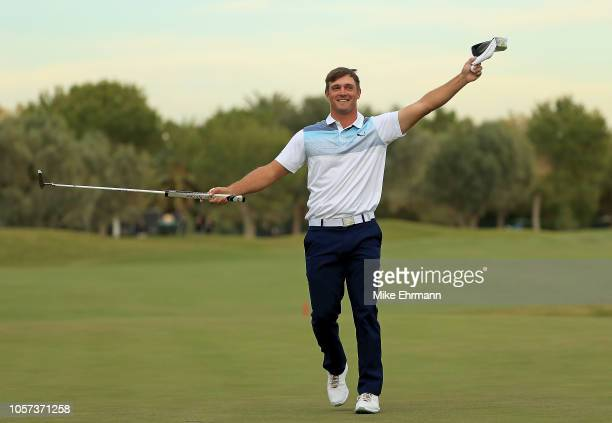 Bryson DeChambeau waves to the crowd after winning the Shriners Hospitals for Children Open at TPC Summerlin on November 4 2018 in Las Vegas Nevada