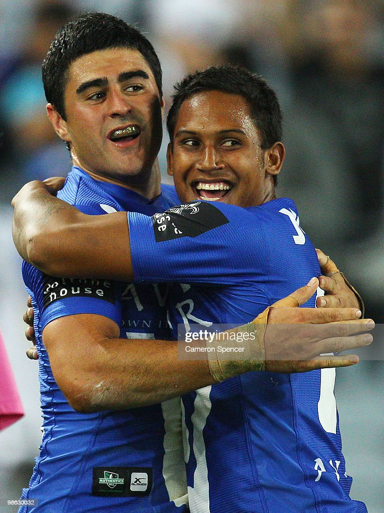 Bryson Goodwin of the Bulldogs celebrates scoring a try with team mate Ben Barba during the round seven NRL match between the Canterbury Bulldogs and the Brisbane Broncos at ANZ Stadium on April 23, 2010 in Sydney, Australia.