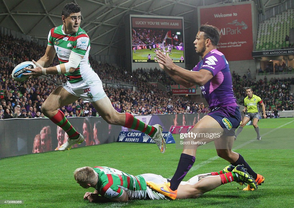 Bryson Goodwin of the Rabbitohs attempts to pass the ball back as he leaps over the dead ball line during the round 10 NRL match between the Melbourne Storm and the South Sydney Rabbitohs at AAMI Park on May 16, 2015 in Melbourne, Australia.