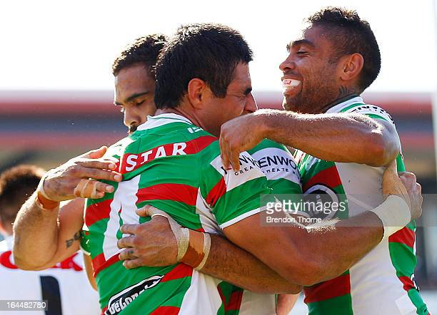 Bryson Goodwin of the Rabbitohs celebrates with team mates after scoring a try during the round three NRL match between the Penrith Panthers and the...