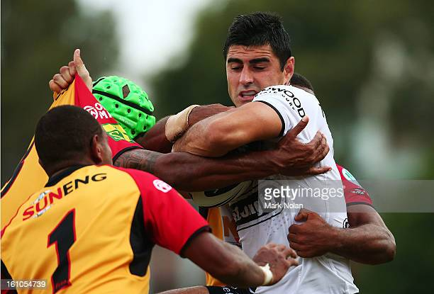 Bryson Goodwin of the Rabbitohs is tackled during the NRL trial match between the South Sydney Rabbitohs and the Papua New Guinea Kumuls at Redfern...