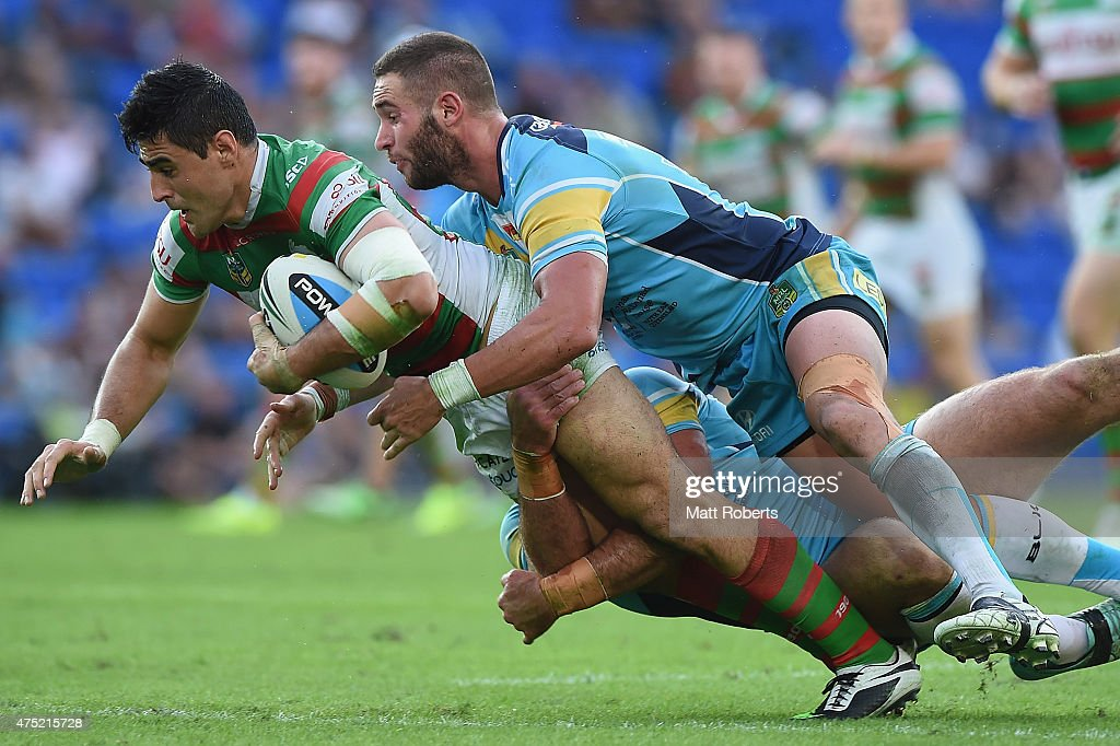 Bryson Goodwin of the Rabbitohs is tackled during the round 12 NRL match between the Gold Coast Titans and the South Sydney Rabbitohs at Cbus Super Stadium on May 30, 2015 on the Gold Coast, Australia.