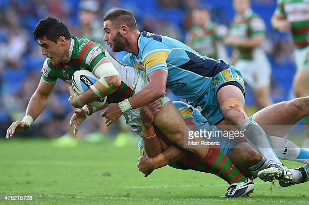 Bryson Goodwin of the Rabbitohs is tackled during the round 12 NRL match between the Gold Coast Titans and the South Sydney Rabbitohs at Cbus Super...