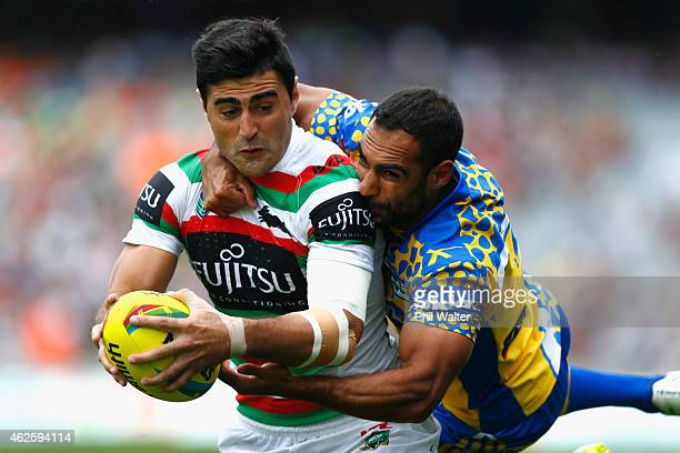 Bryson Goodwin of the Rabbitohs scores a try in the tackle of Reece Robinson of the Eels during the match between the Rabbitohs and the Eels in the...