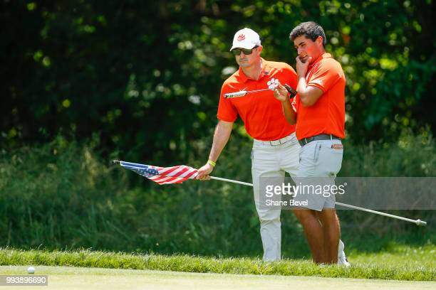 Bryson Nimmer of Clemson right speaks with associate head coach Jordan Byrd during the Division I Men's Golf Individual Stroke Play Championship held...