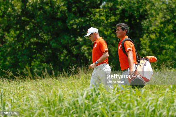 Bryson Nimmer of Clemson right walks along the fairway with associate head coach Jordan Byrd during the Division I Men's Golf Individual Stroke Play...
