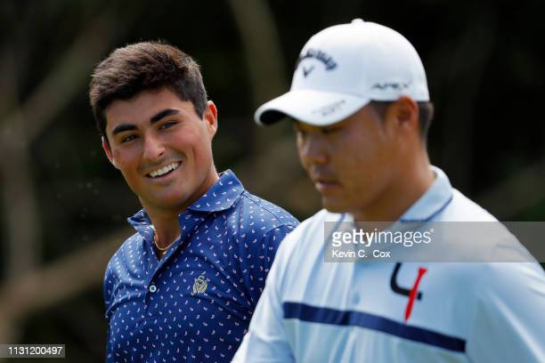 Bryson Nimmer speaks with John Chin during the first round of the Puerto Rico Open at Coco Beach Golf and Country Club on February 21 2019 in Rio...