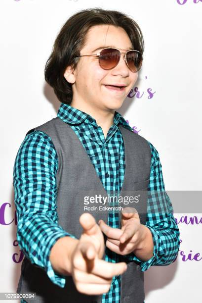 Bryson Robinson attends Chandler Kinney's 3rd Annual Holiday Toy Drive Event on December 09 2018 in Los Angeles California