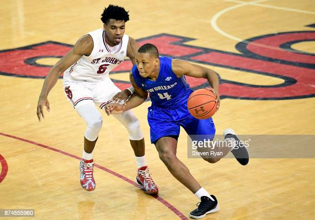 Bryson Robinson of New Orleans is defended by Justin Simon of St John's during an NCAA basketball game at Carnesecca Arena on November 10 2017 in the...