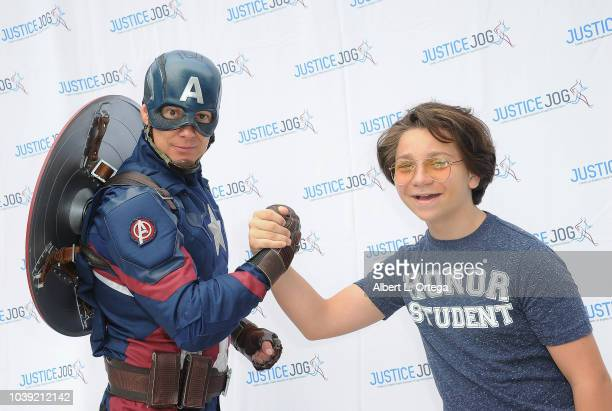 Bryson Robinson poses with Captain America at the 11th Annual Justice Jog To Benefit Casa LA held on September 23 2018 in Century City California
