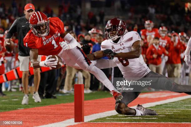 Bryson Smith of the Houston Cougars is forced out of bounds by Rock YaSin of the Temple Owls in the third quarter at TDECU Stadium on November 10...