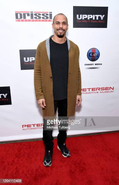 Bryton James attends the premiere of Uppity The Willy T Ribbs Story at Petersen Automotive Museum on February 04 2020 in Los Angeles California