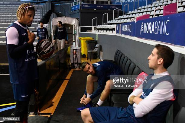 Bàsquet Club Andorra's basketball player Andrew Albicy talks with teammates Andorra's Guille Colom and Czech Republic's David Jelinek during a...