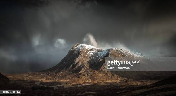 buachaille etive mor, glencoe during stormy conditions. - grampian scotland stock pictures, royalty-free photos & images