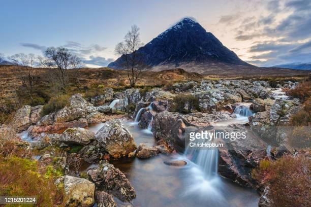 buachaille etive mor in early morning light, glencoe, scotland - glen etive mor stock pictures, royalty-free photos & images