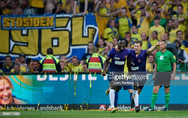 Bubacarr Sanneh and Erik Sviatchenko of FC Midtjylland celebrate after scoring their first goal during the Danish Alka Superliga match between...