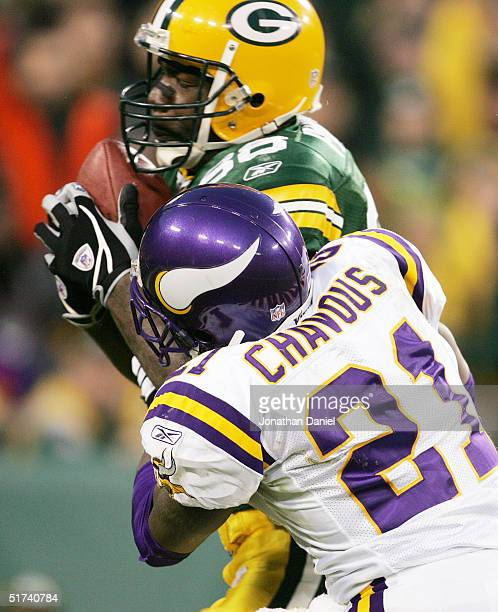 Bubba Franks of the Green Bay Packers hauls in a touchdown pass as Corey Chavous of the Minnesota Vikings tries to stop him during a game at Lambeau...