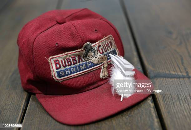 A Bubba Gump cap worn by Tom Hanks in the film Forrest Gump alongside a feather from the same film in the Prop Store head office near Rickmansworth...