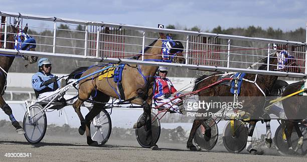 Bubba Mcgee is driven by Kevin Switzer as the first race begins Saturday during the opening day of harness racing at Scarborough Downs Live racing...