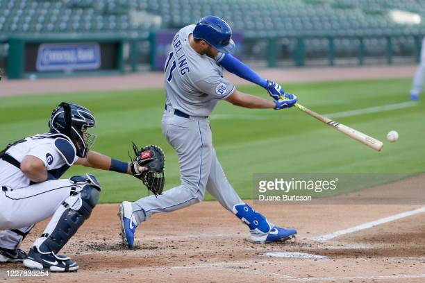 Bubba Starling of the Kansas City Royals singles to drive in Adalberto Mondesi as Grayson Greiner of the Detroit Tigers works behind the plate during...