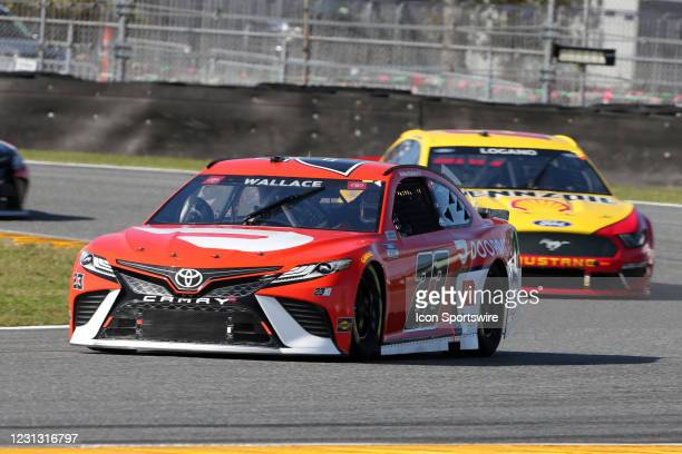 Bubba Wallace, 23XI Racing, Toyota Camry DoorDash, #22: Joey Logano, Team Penske, Ford Mustang Shell Pennzoil during the running of the O'Reilly Auto...