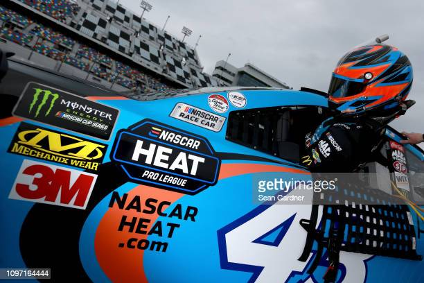 Bubba Wallace driver of the Aftershokz Chevrolet stands on the grid during qualifying for the Monster Energy NASCAR Cup Series 61st Annual Daytona...