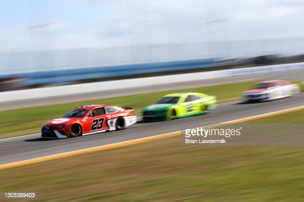 Bubba Wallace, driver of the DoorDash Toyota, drives during the NASCAR Cup Series O'Reilly Auto Parts 253 at Daytona International Speedway on...
