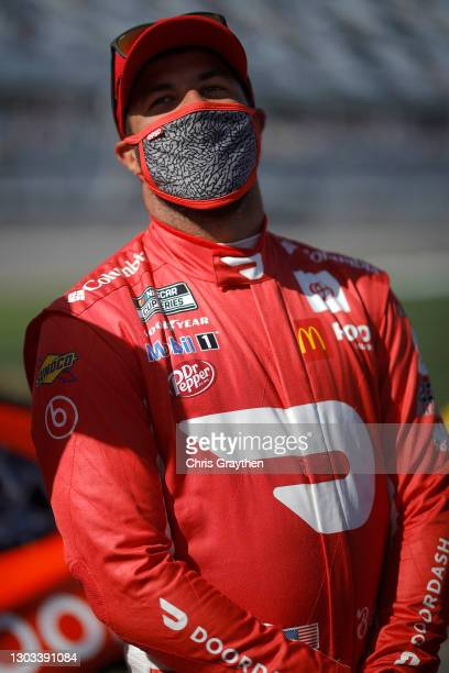 Bubba Wallace, driver of the DoorDash Toyota, waits on the grid prior to the NASCAR Cup Series O'Reilly Auto Parts 253 at Daytona International...