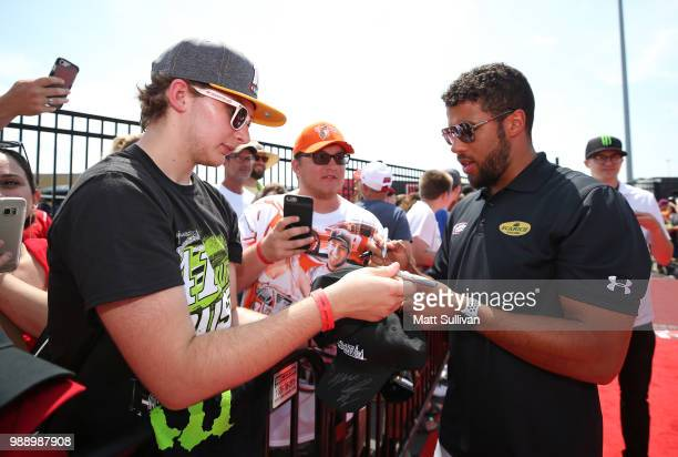 Bubba Wallace driver of the JewelOsco Chevrolet signs autographs prior to the Monster Energy NASCAR Cup Series Overton's 400 at Chicagoland Speedway...