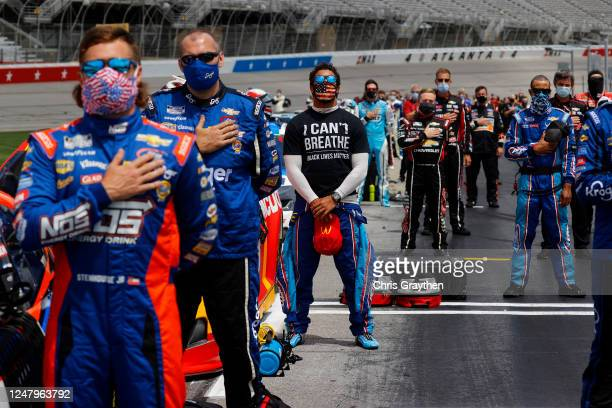 Bubba Wallace driver of the McDonald's Chevrolet wears a I Can't Breathe Black Lives Matter Tshirt under his fire suit in solidarity with protesters...