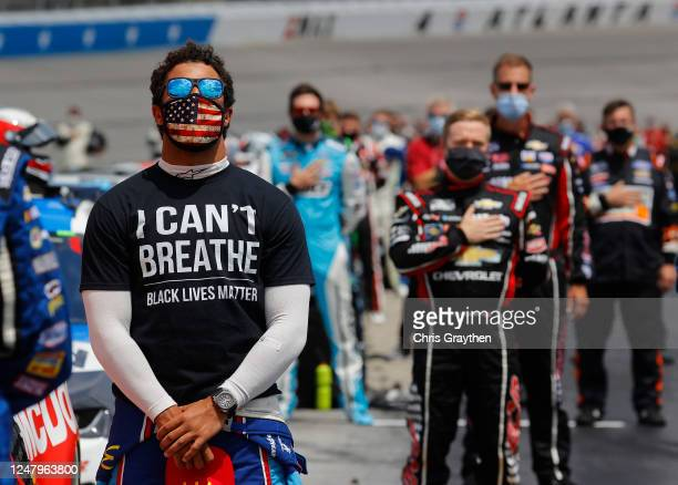 "Bubba Wallace, driver of the McDonald's Chevrolet, wears a ""I Can't Breathe - Black Lives Matter"" T-shirt under his fire suit in solidarity with..."