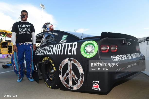 Bubba Wallace driver of the Richard Petty Motorsports Chevrolet wears a I Can't Breathe Black Lives Matter tshirt under his fire suit in solidarity...