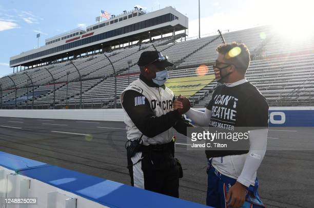 Bubba Wallace driver of the Richard Petty Motorsports Chevrolet wears a I Can't Breathe Black Lives Matter tshirt under his firesuit in solidarity...