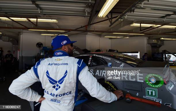 Bubba Wallace driver of the United States Air Force Chevrolet looks on from the garage during practice for the Monster Energy NASCAR Cup Series Coke...
