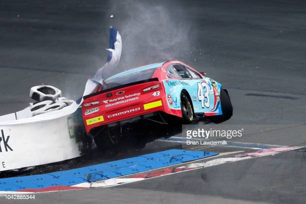 Bubba Wallace driver of the World Wide Technology Chevrolet crashes into a tire barrier during practice for the Monster Energy NASCAR Cup Series Bank...