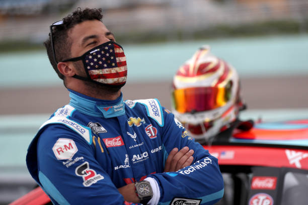Bubba Wallace driver of the World Wide Technology Chevrolet stands on the grid prior to the NASCAR Cup Series Dixie Vodka 400 at HomesteadMiami...