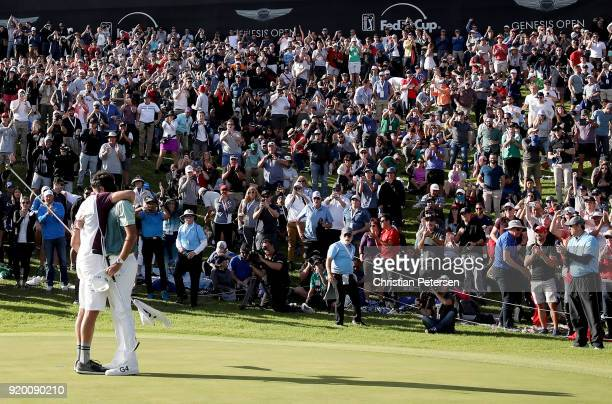 Bubba Watson and caddie Ted Scott celebrate after winning the Genesis Open at Riviera Country Club on February 18 2018 in Pacific Palisades California