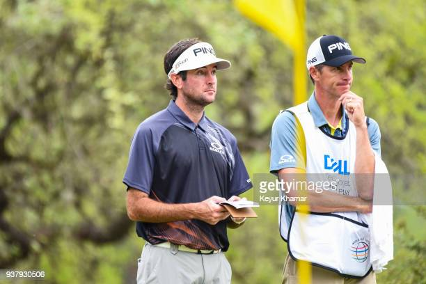 Bubba Watson and his caddie Ted Scott wait to putt on the 10th hole green during the championship match at the World Golf ChampionshipsDell...
