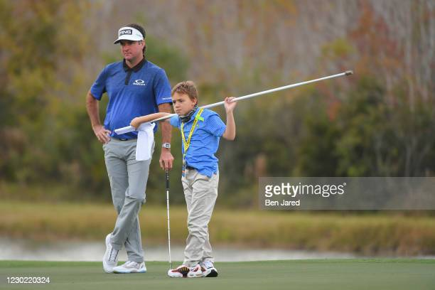 Bubba Watson and his son Caleb Watson stand together on the 14th green during the first round of the PGA TOUR Champions PNC Championship at...