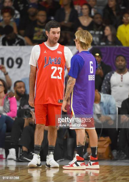 Bubba Watson and Justin Bieber speak during the 2018 NBA AllStar Game Celebrity Game at Los Angeles Convention Center on February 16 2018 in Los...